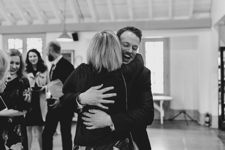 groom hugs his mom at wedding - The Cameron Wedding