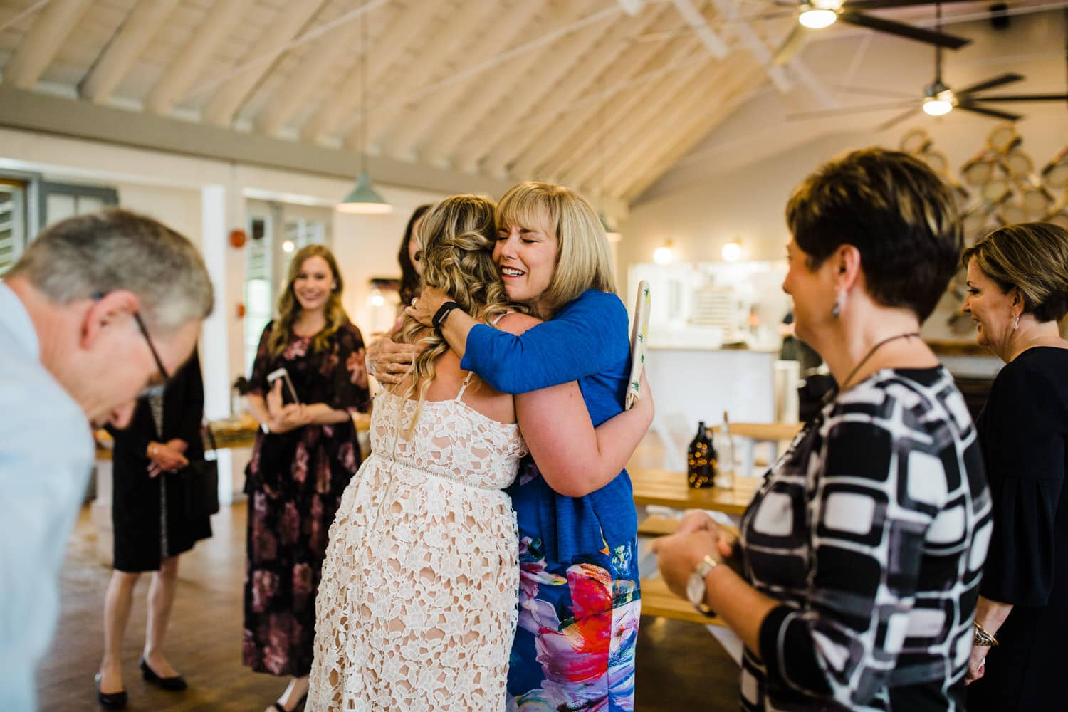 bride hugs mother in law - small ottawa wedding at The Cameron