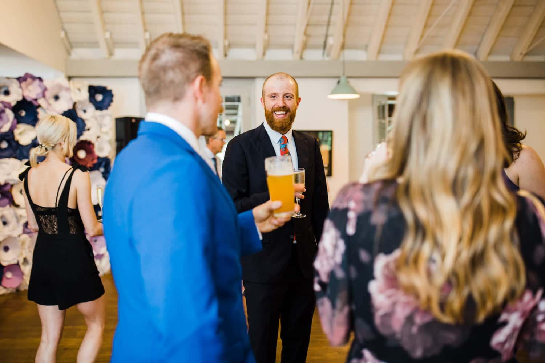 guests mingle at small ottawa wedding - The Cameron
