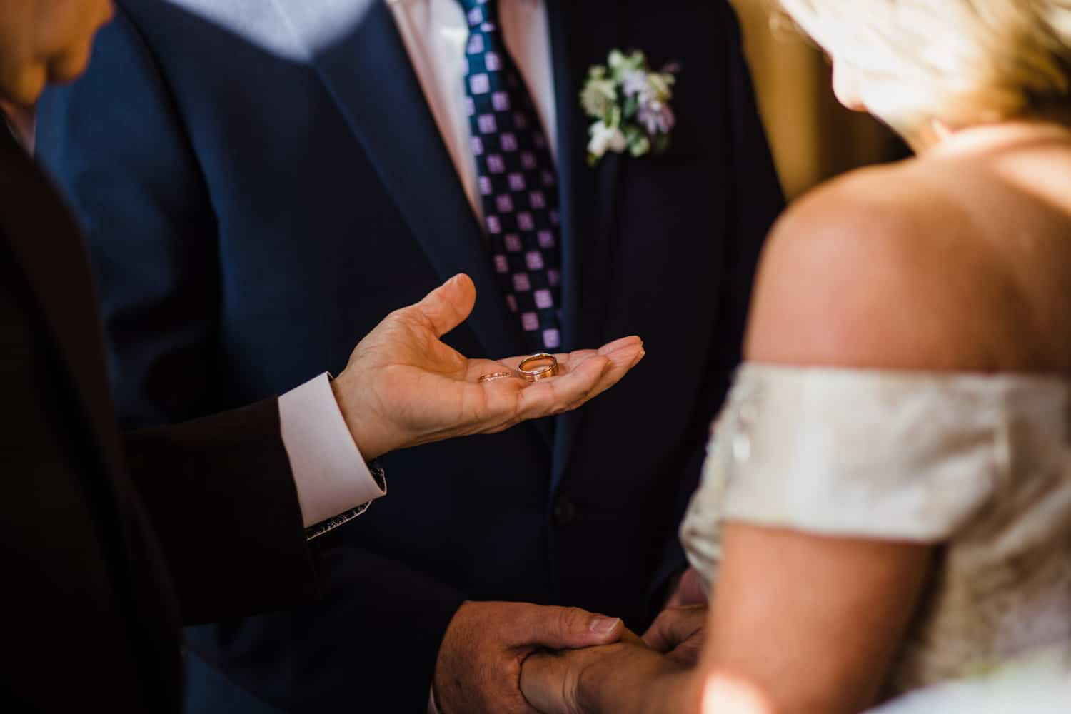 Couple exchange rings during wedding ceremony