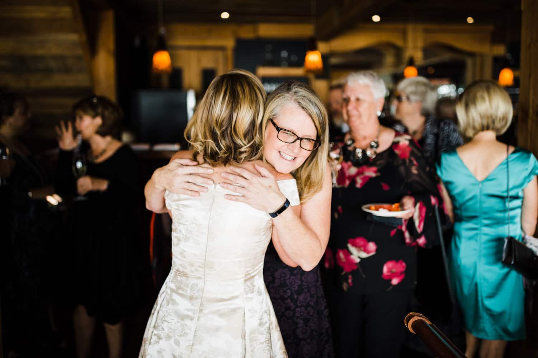 bride hugs guests after wedding ceremony