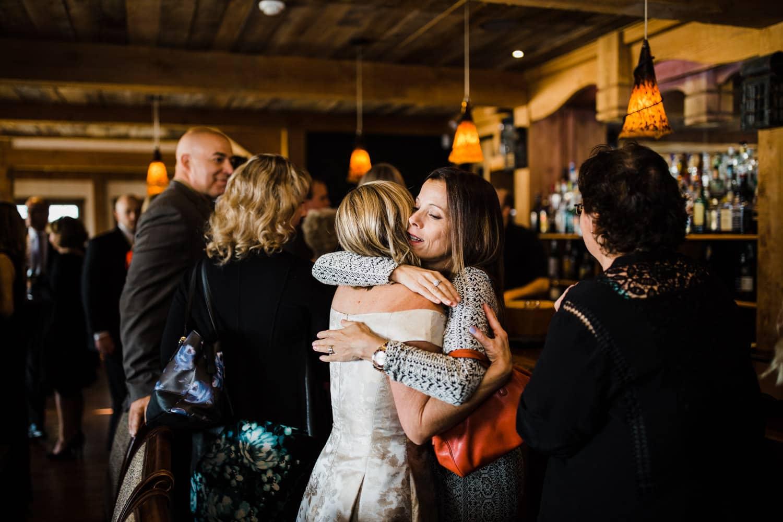 bride hugs guests - the ivy lea club wedding