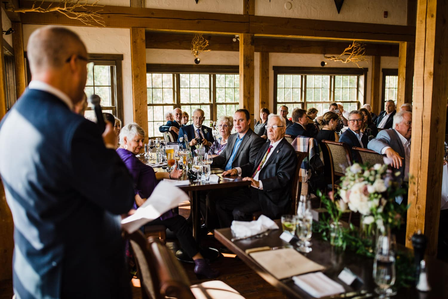 guests listen to speech at small luncheon wedding