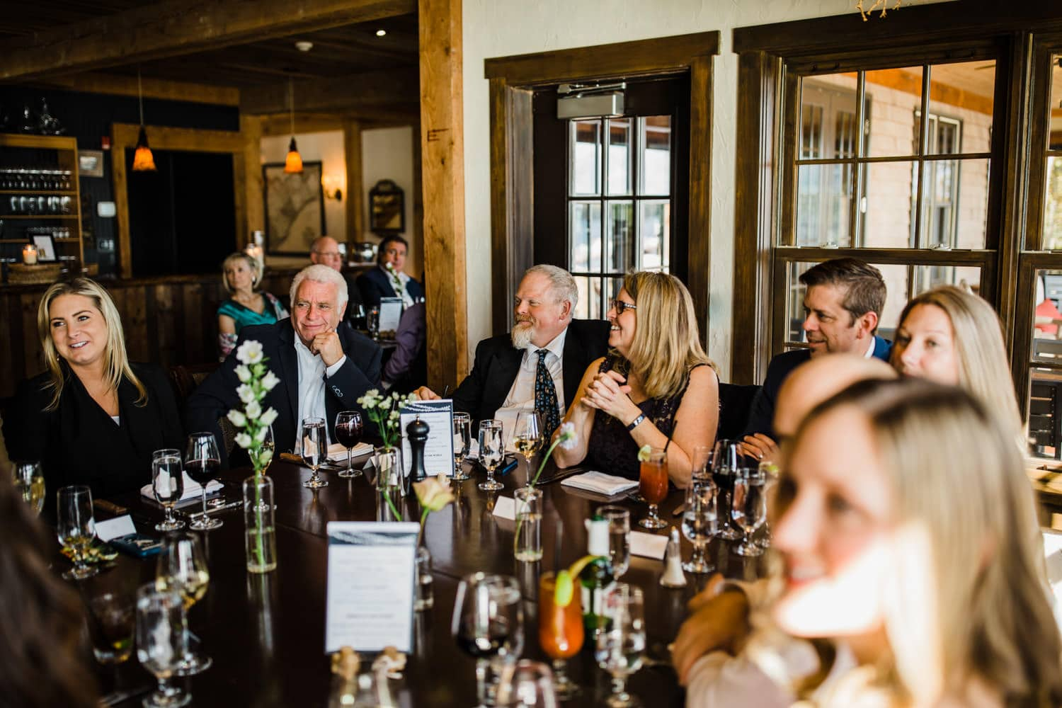 guests listen to speeches at small luncheon wedding