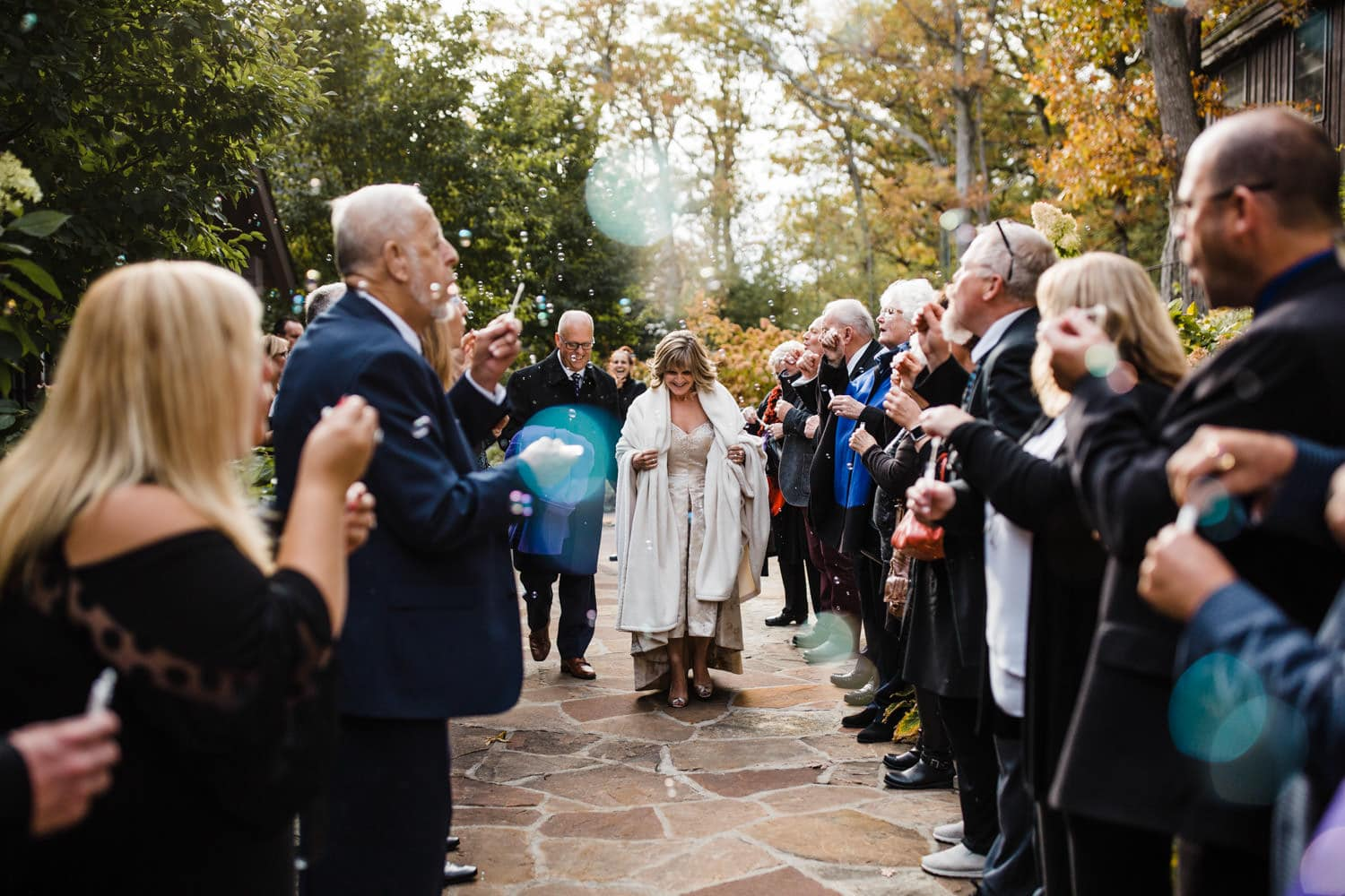 guests blow bubbles for couples wedding exit - the ivy lea club wedding