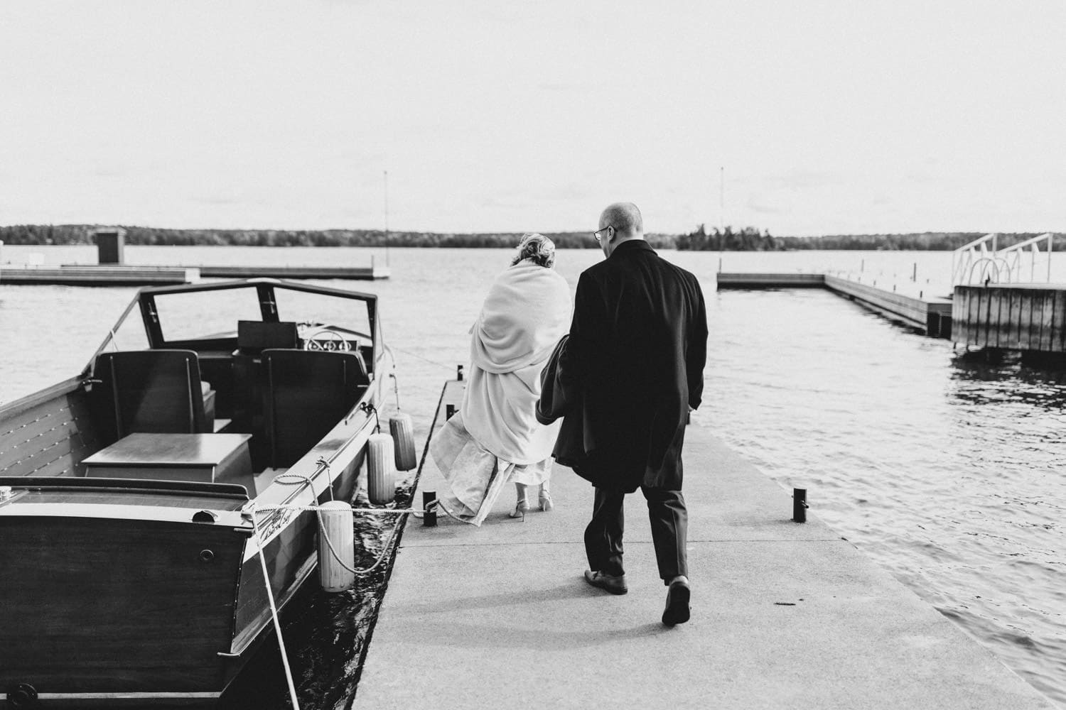 couple make exit on antique boat - ivy lea club wedding