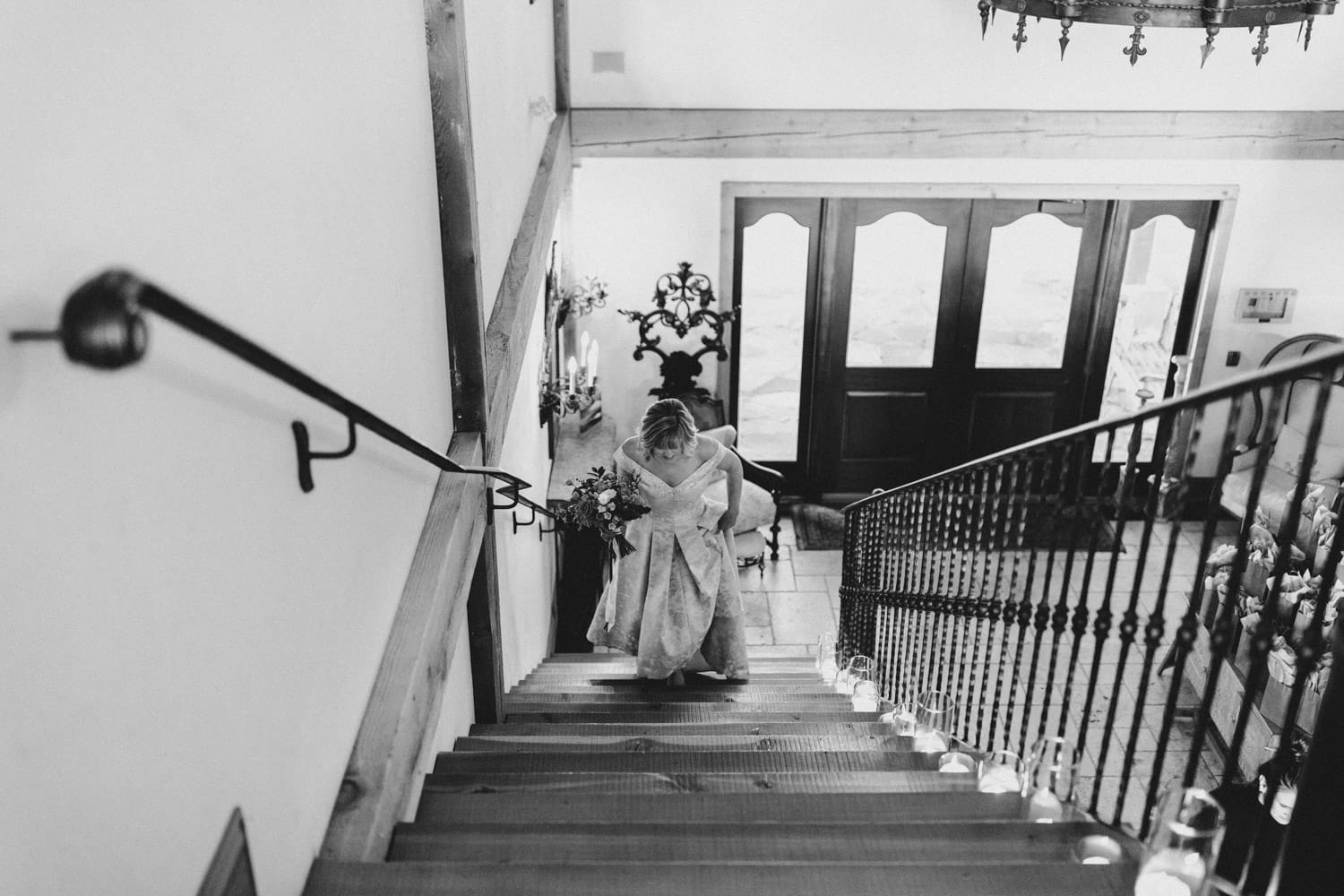 bride ascends stairs at the ivy lea club fall wedding
