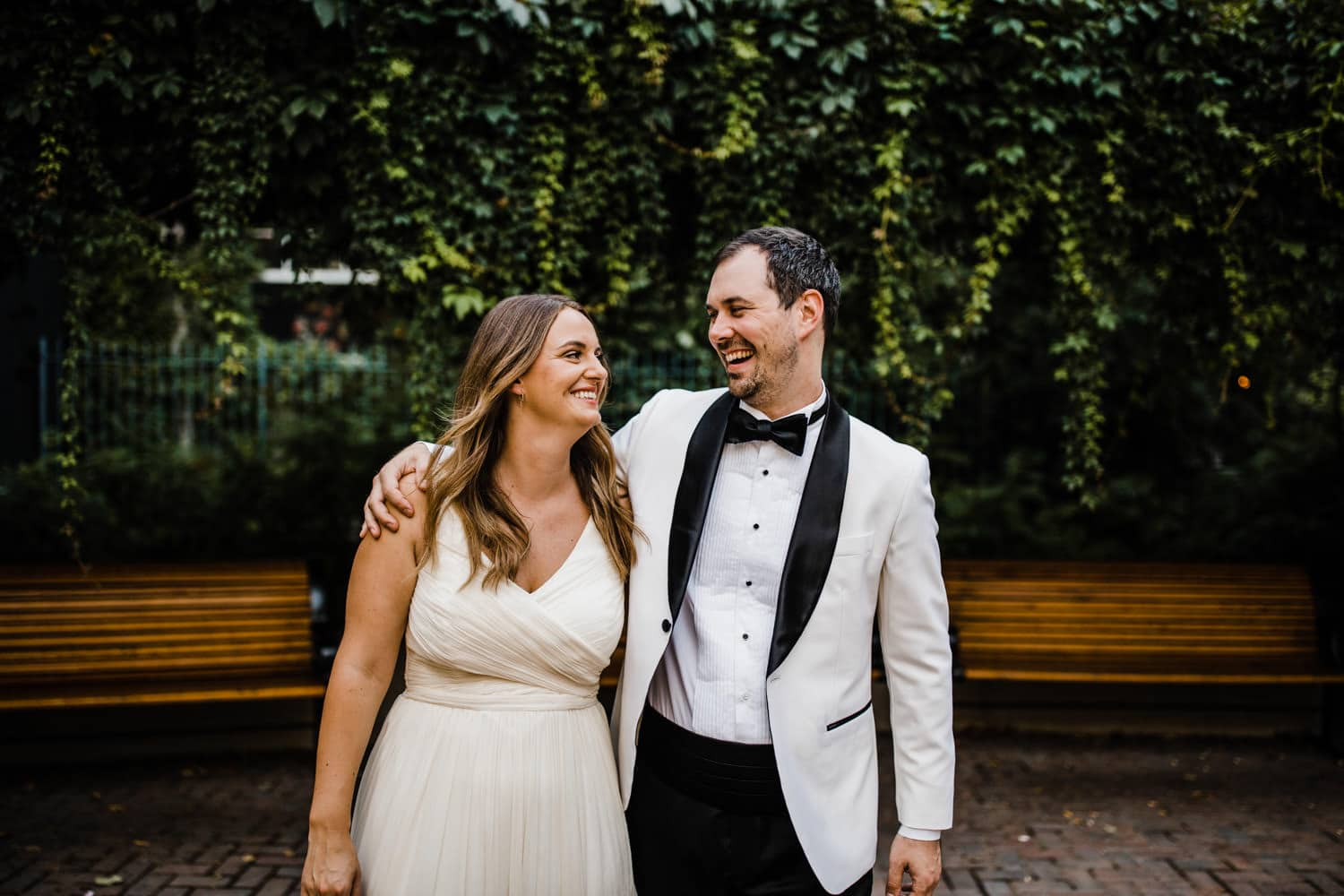 couple laugh together - summer wedding at the sussex contemporary