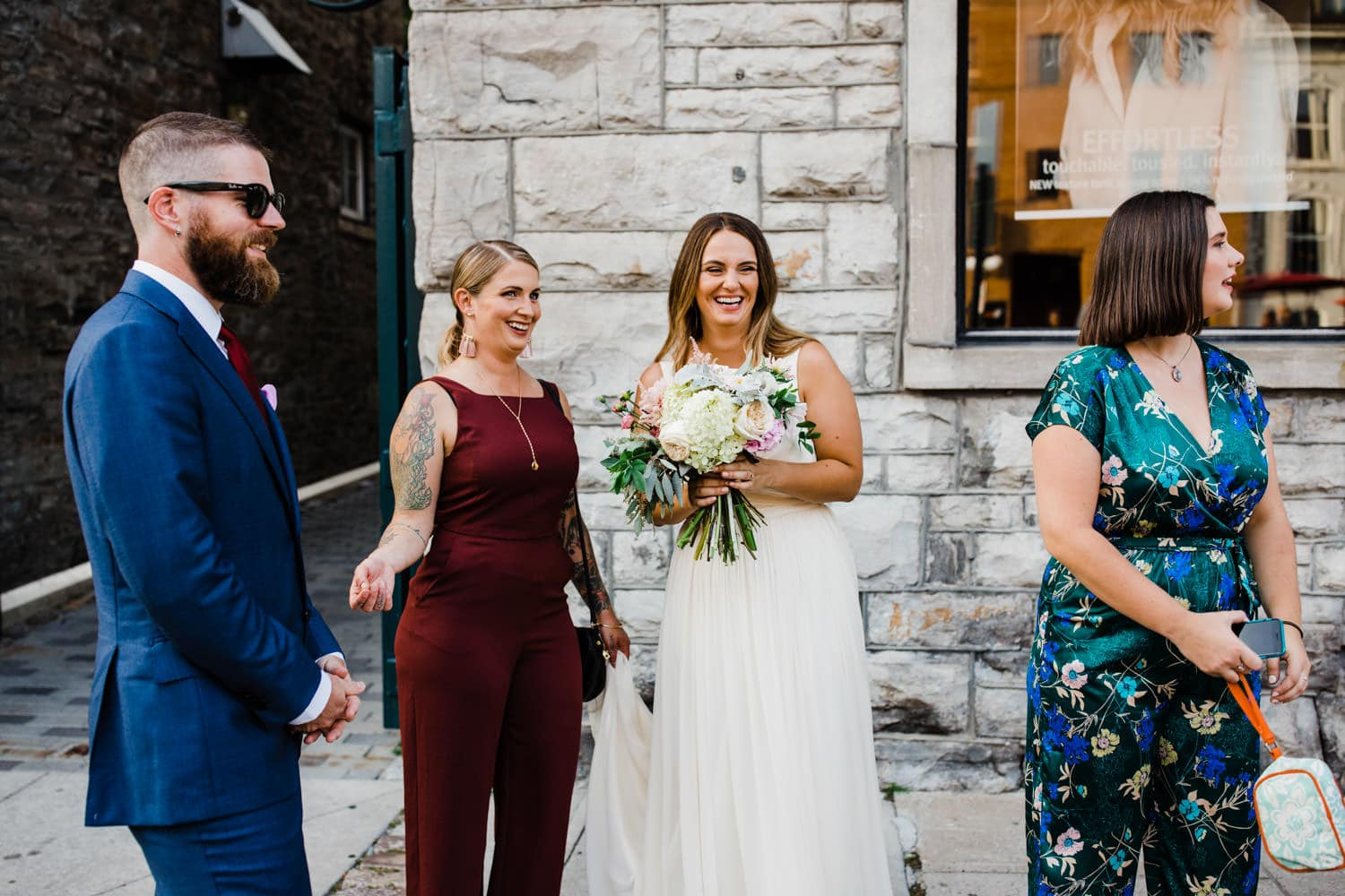 bride laughs with family in byward market - small ottawa wedding