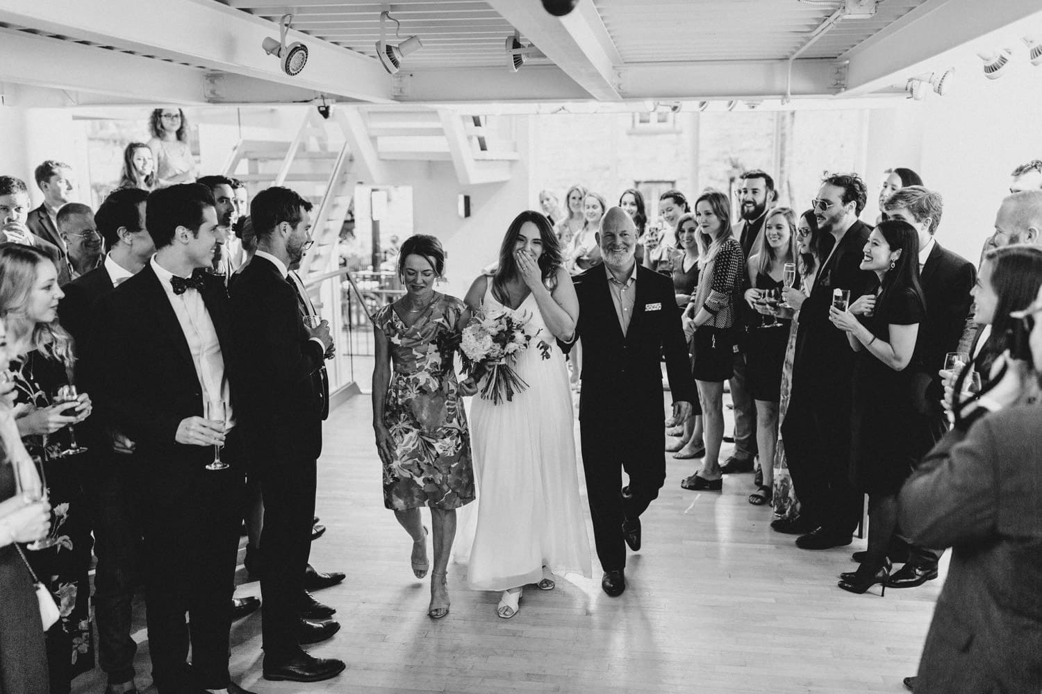 bride walks in to small wedding at the sussex contemporary