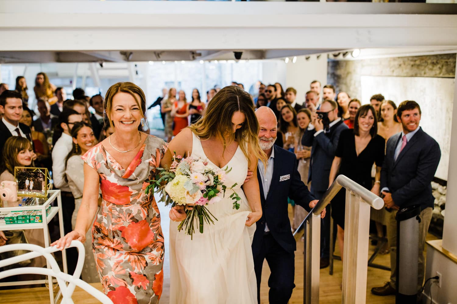 bride walks in to ceremony at the sussex contemporary