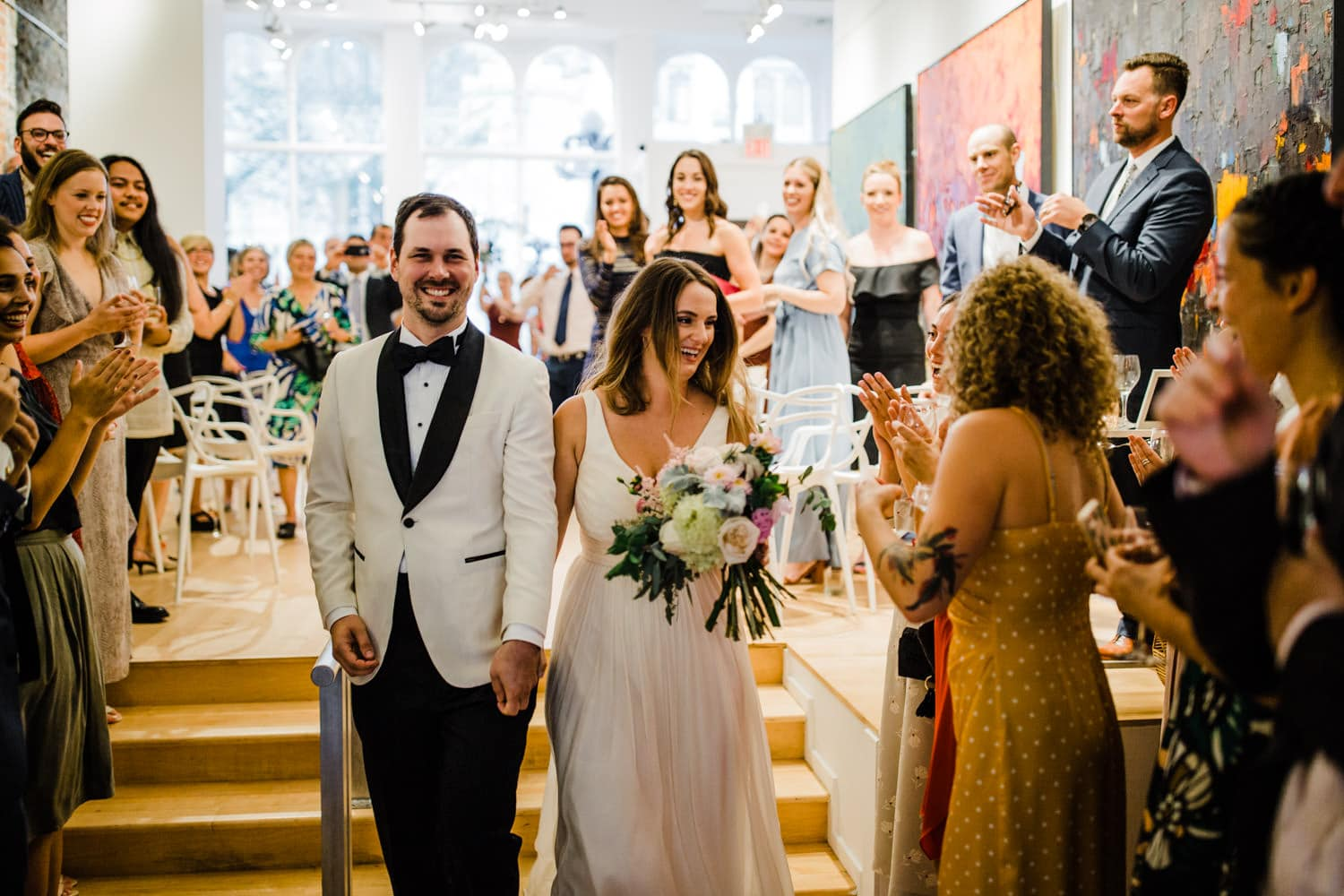 bride and groom exit ceremony - the sussex contemporary