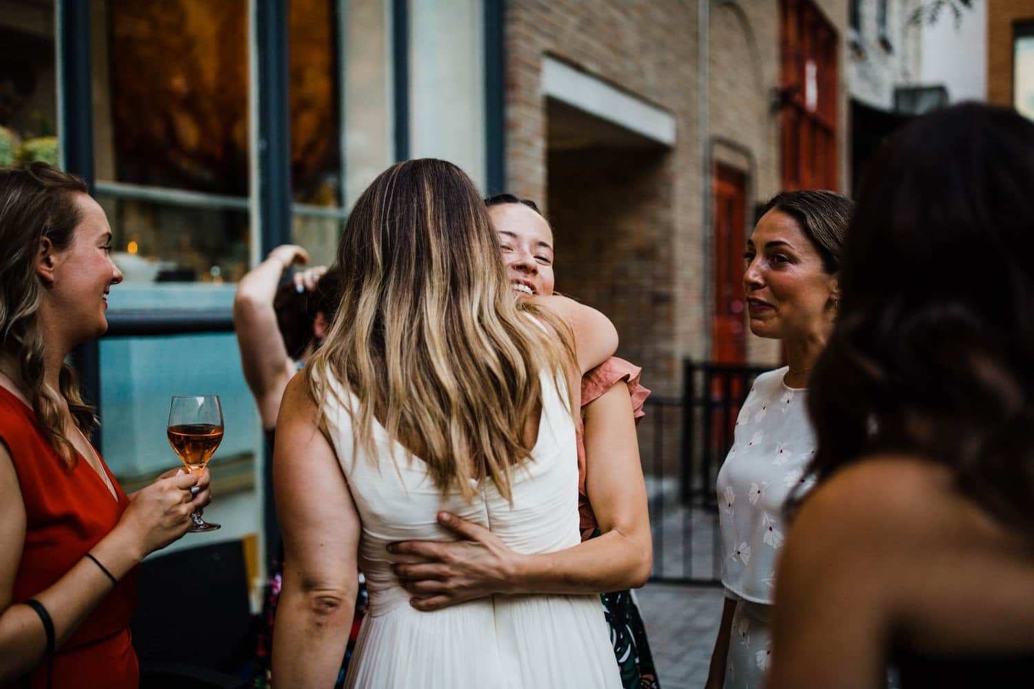 bride hugs friends after the ceremony - small ottawa wedding
