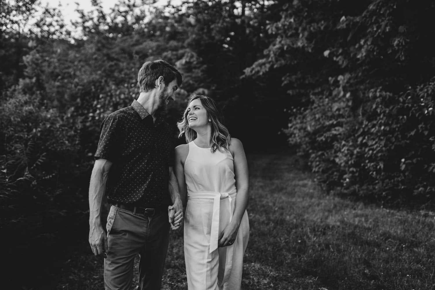 couple walk and laugh together outside