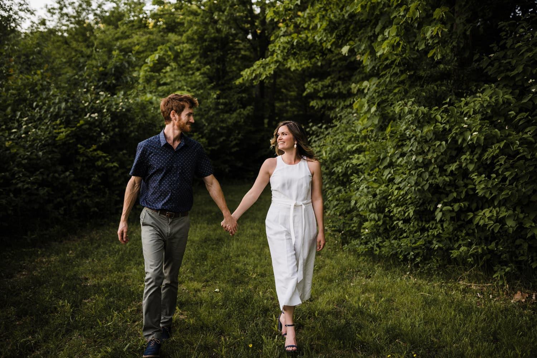 couple walk together outside - cottage engagement session