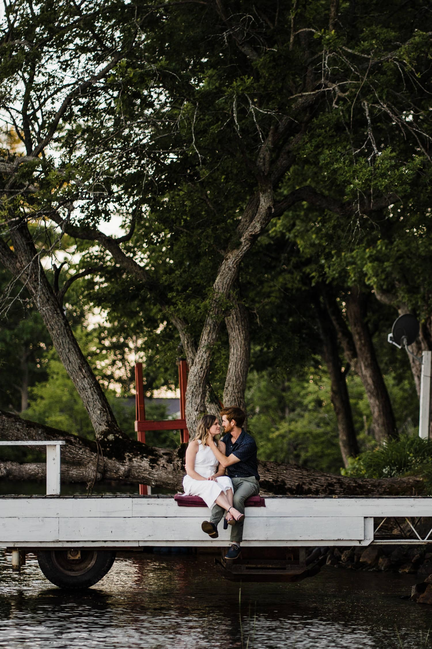 couple sit on dock together