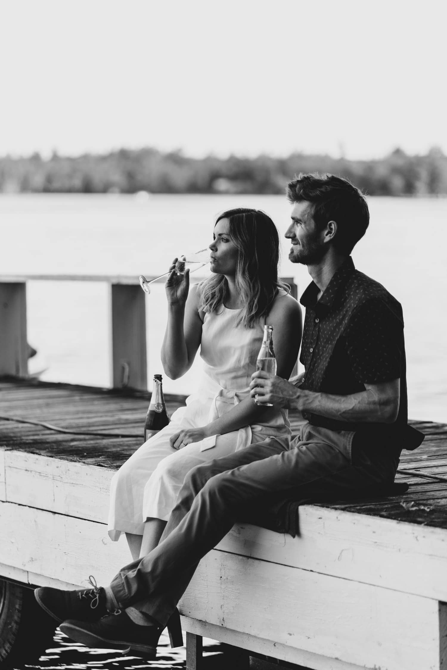 couple have a drink on the dock