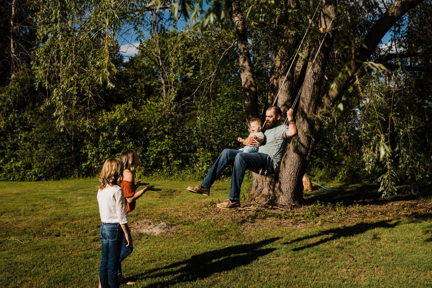 family plays on rope swing in backyard - ottawa lifestyle family photos