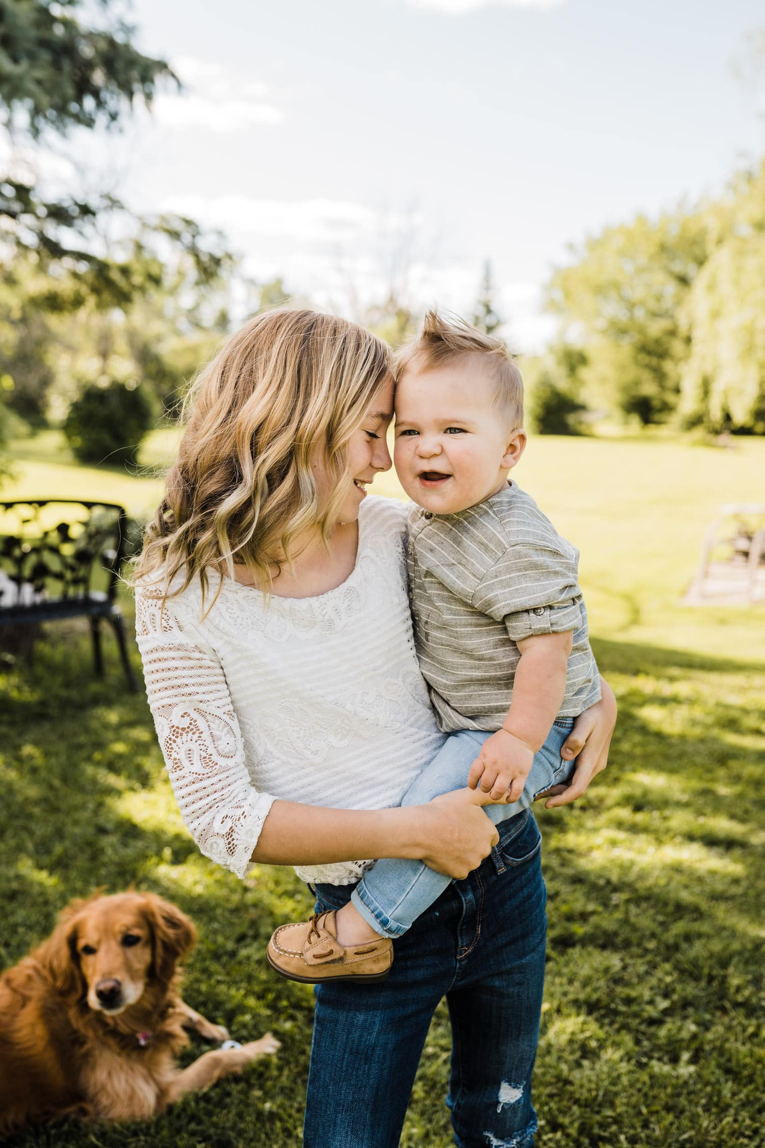 older sister snuggles with her baby brother - lifestyle family photos ottawa
