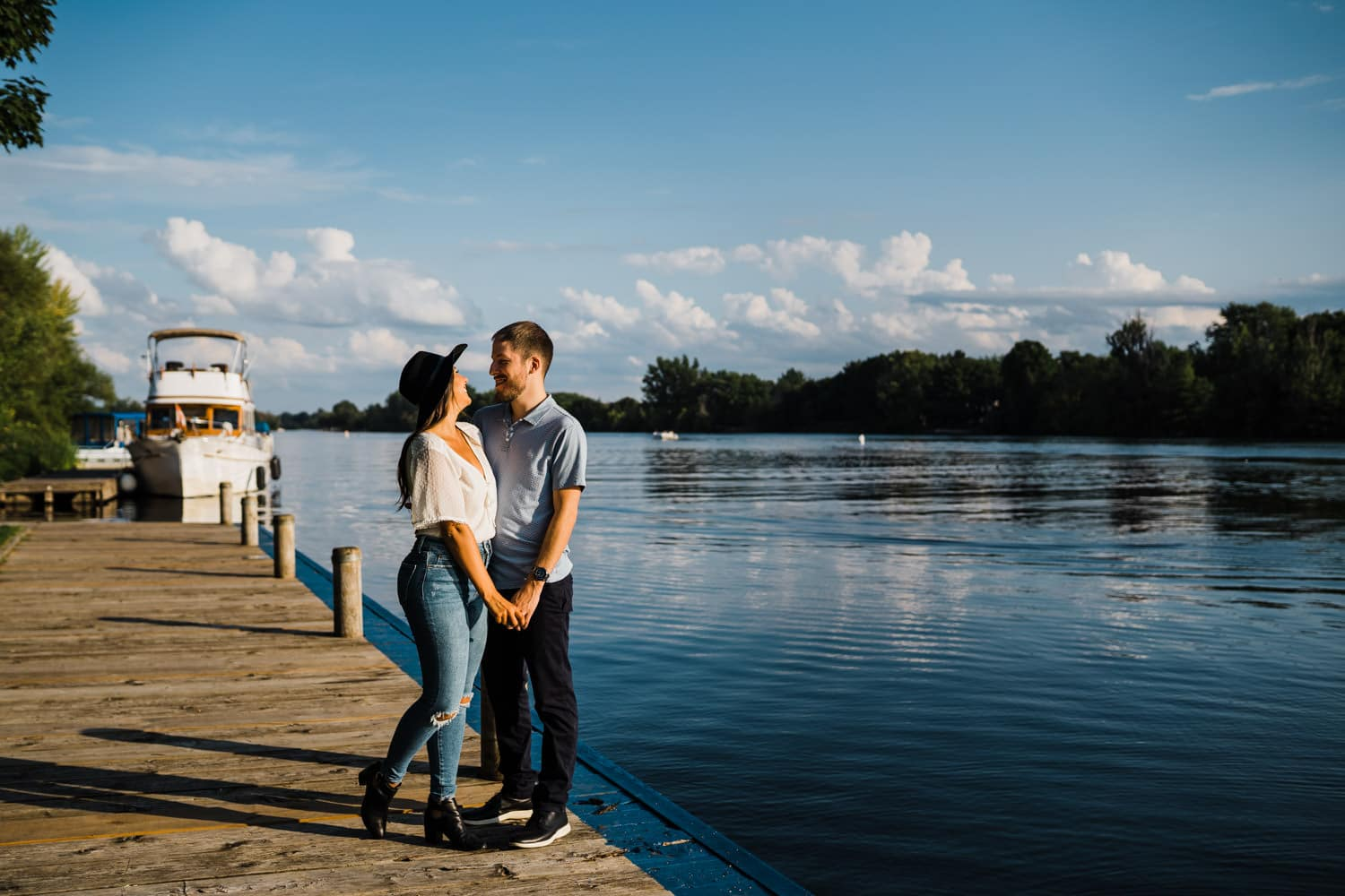 couple stand on dock along the rideau river - ottawa anniversary session