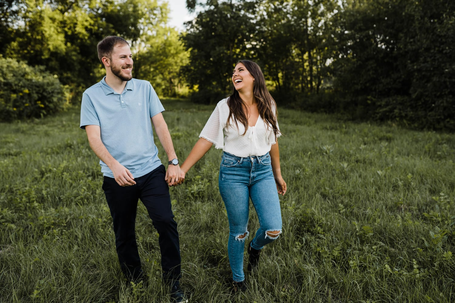 couple holds hands and laugh together outside - ottawa anniversary session