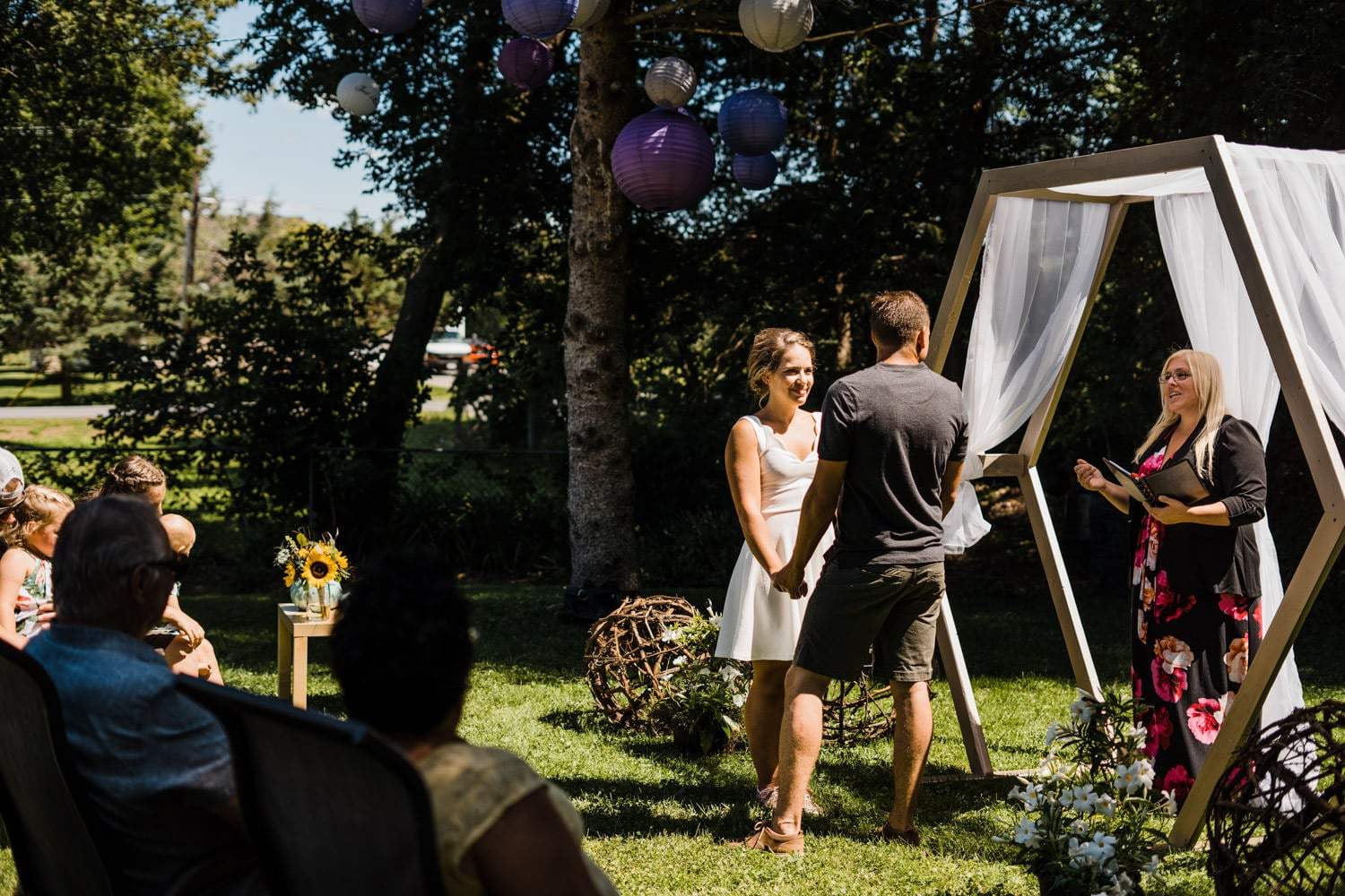 bride and groom share vows at backyard wedding