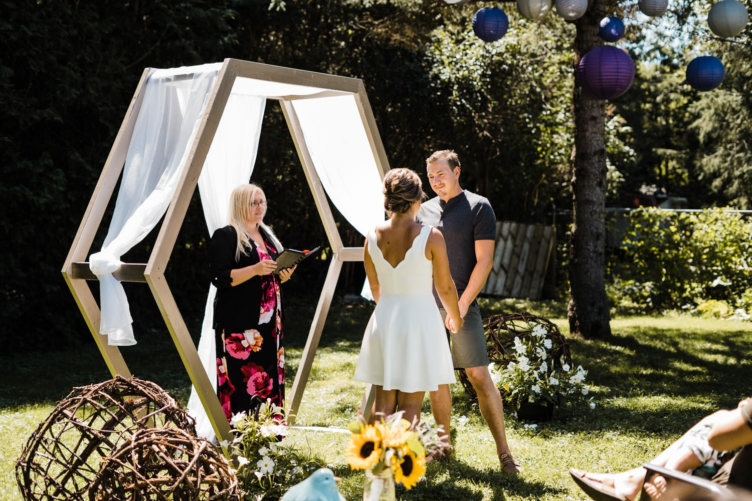 couple share vows at backyard wedding
