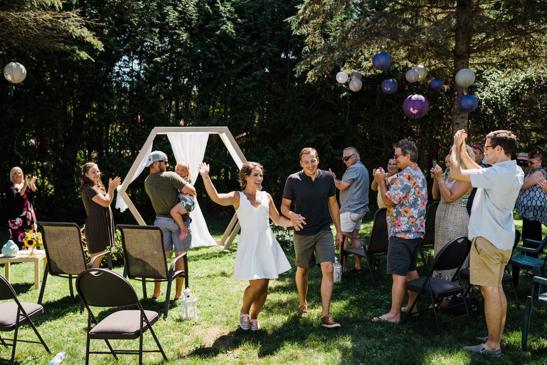 couple celebrate after backyard wedding