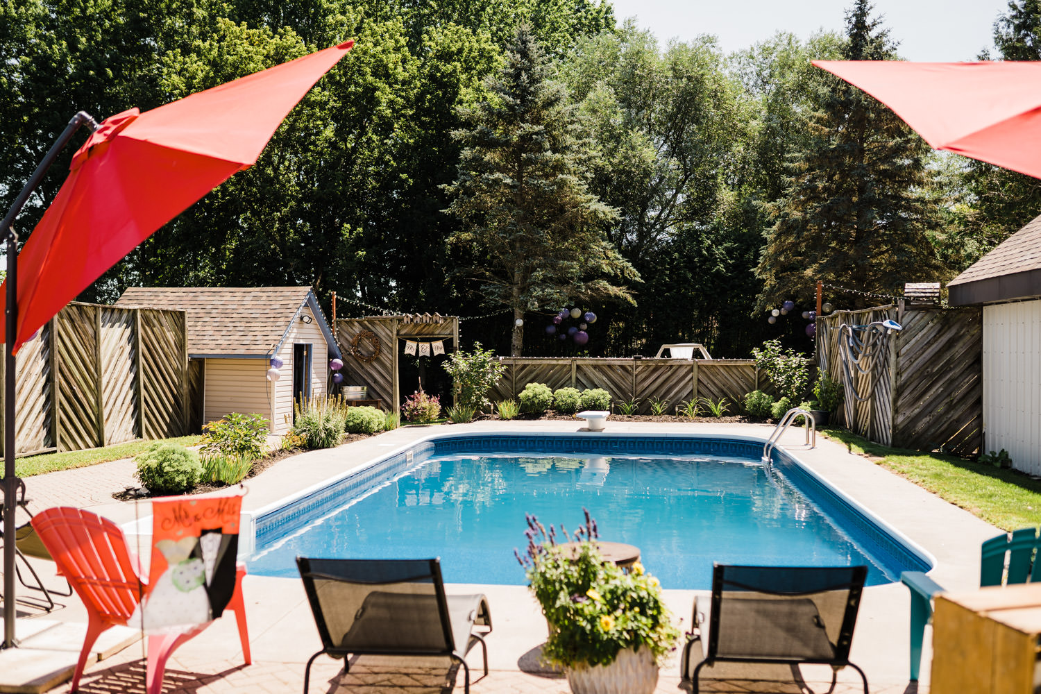 backyard with a pool all set for small wedding bbq