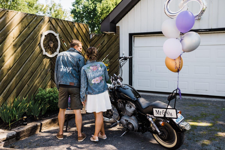 just married jean jackets at backyard wedding bbq