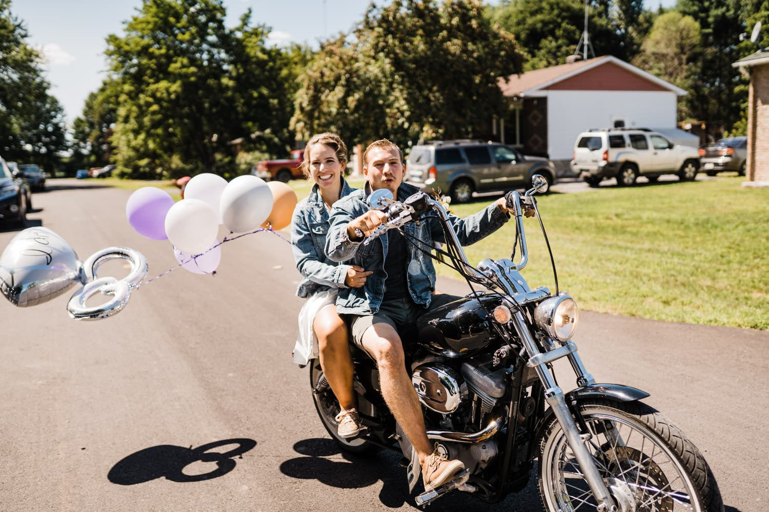 couple go for motorcycle ride after backyard wedding