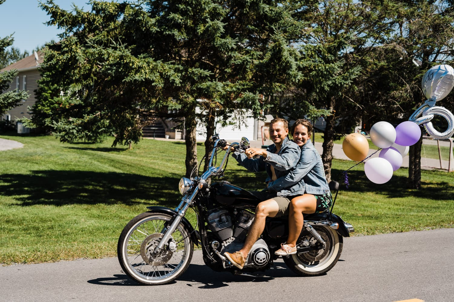bride and groom take a motorcycle ride