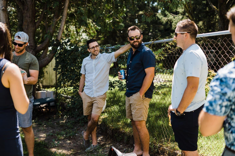 guests hang out at chat at socially distant backyard wedding