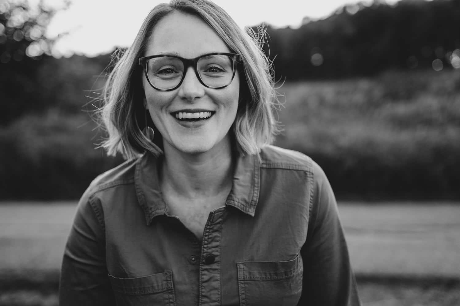 black and white portrait of a woman laughing at the camera - ottawa lifestyle portraits