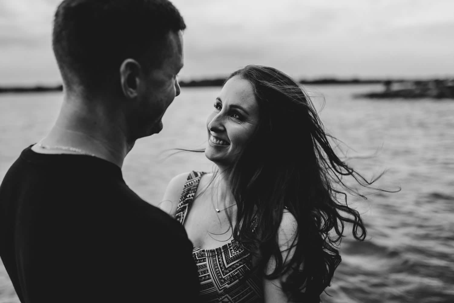 Couple laugh together in the water
