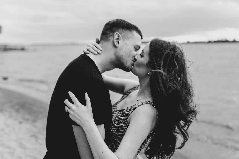 Couple kiss on the beach - Petrie Island Engagement Ottawa Beach Engagement