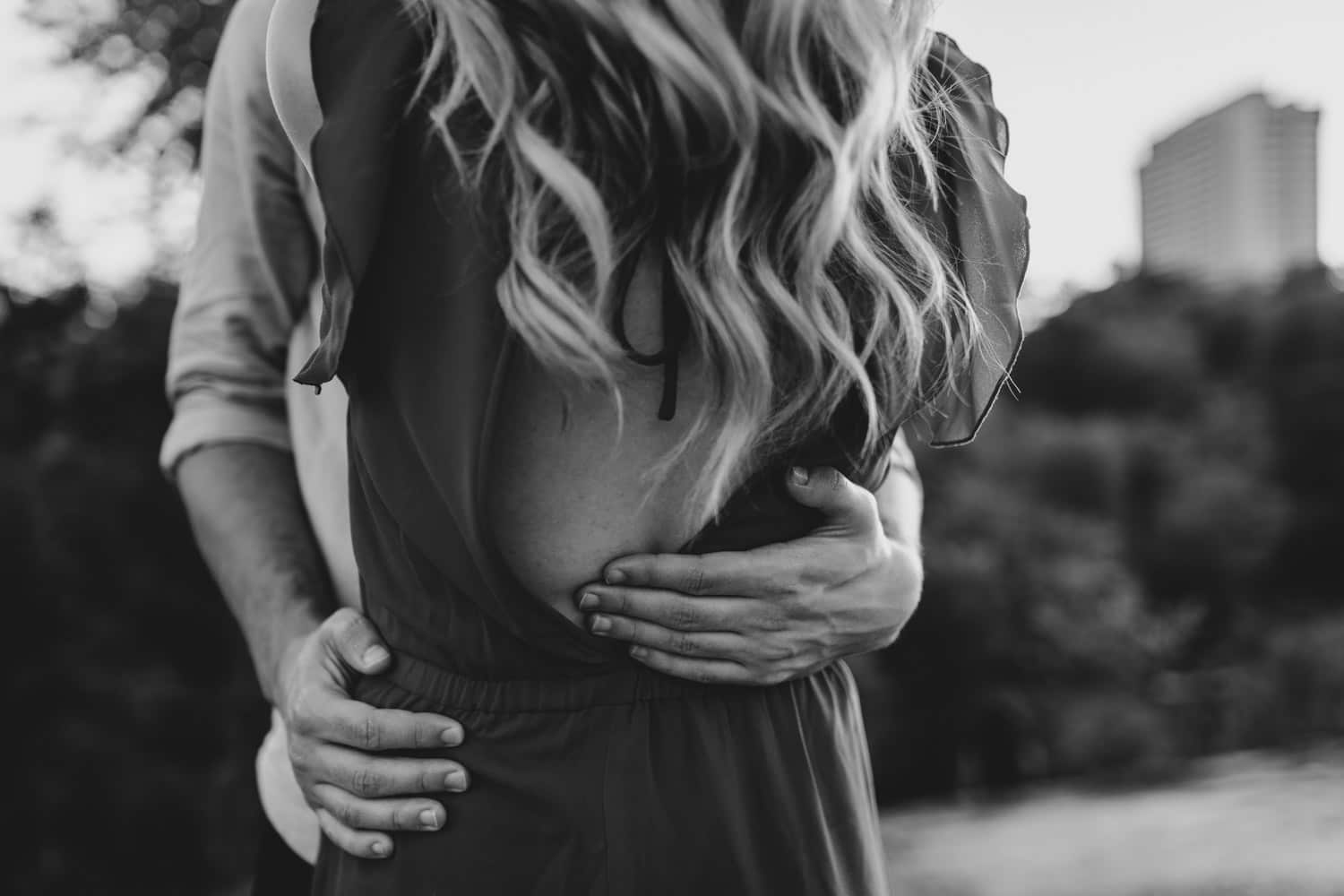 couple hugs in black and white photo