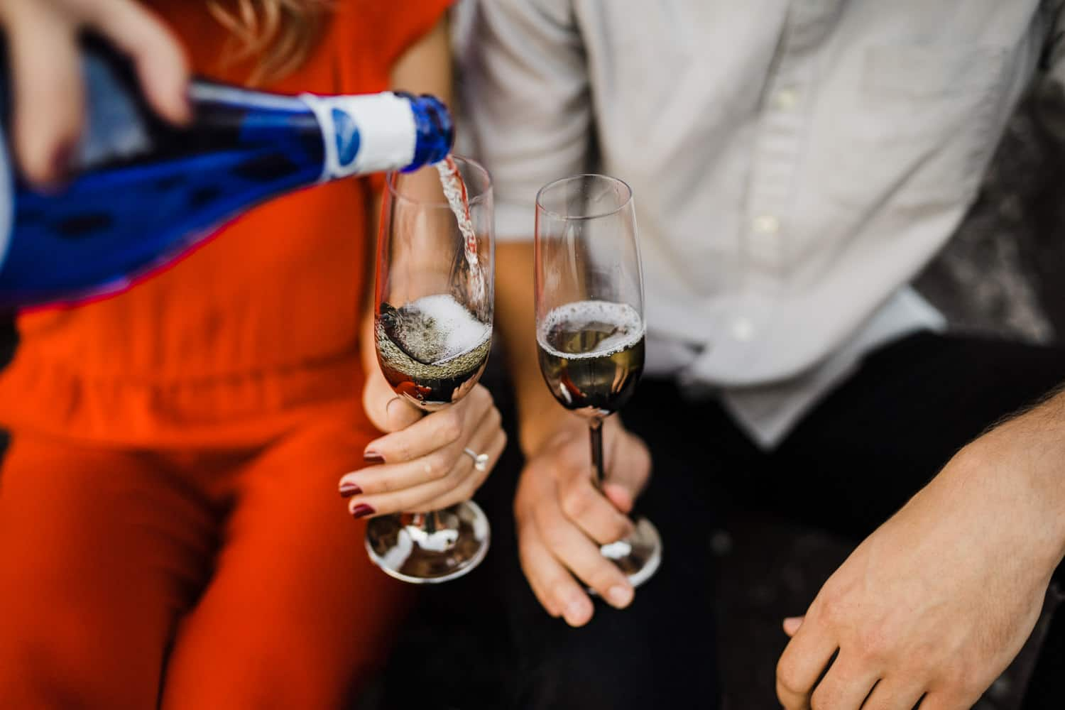 couple pour champagne together