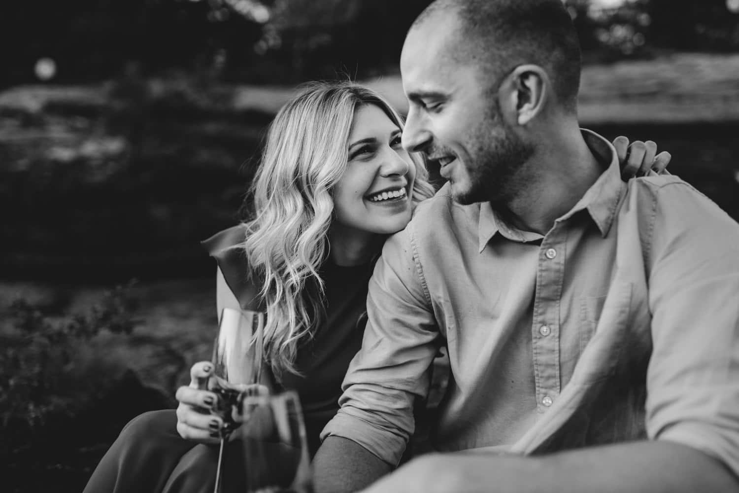 couple sit close together - carley teresa photography