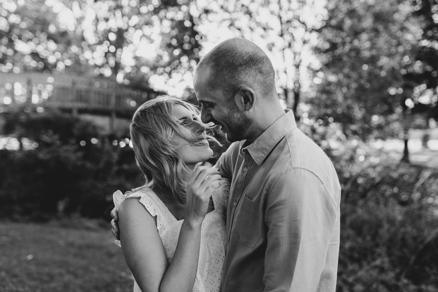 woman's hair blows during summer engagement session
