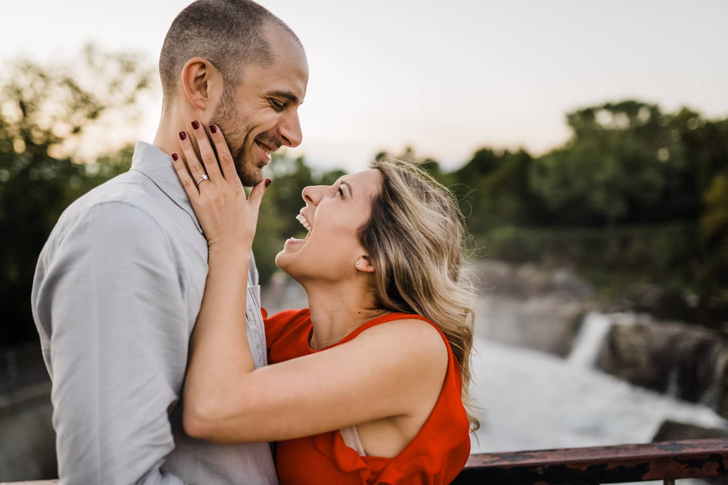 couple laughs together - hogs back engagement session - carley teresa photography