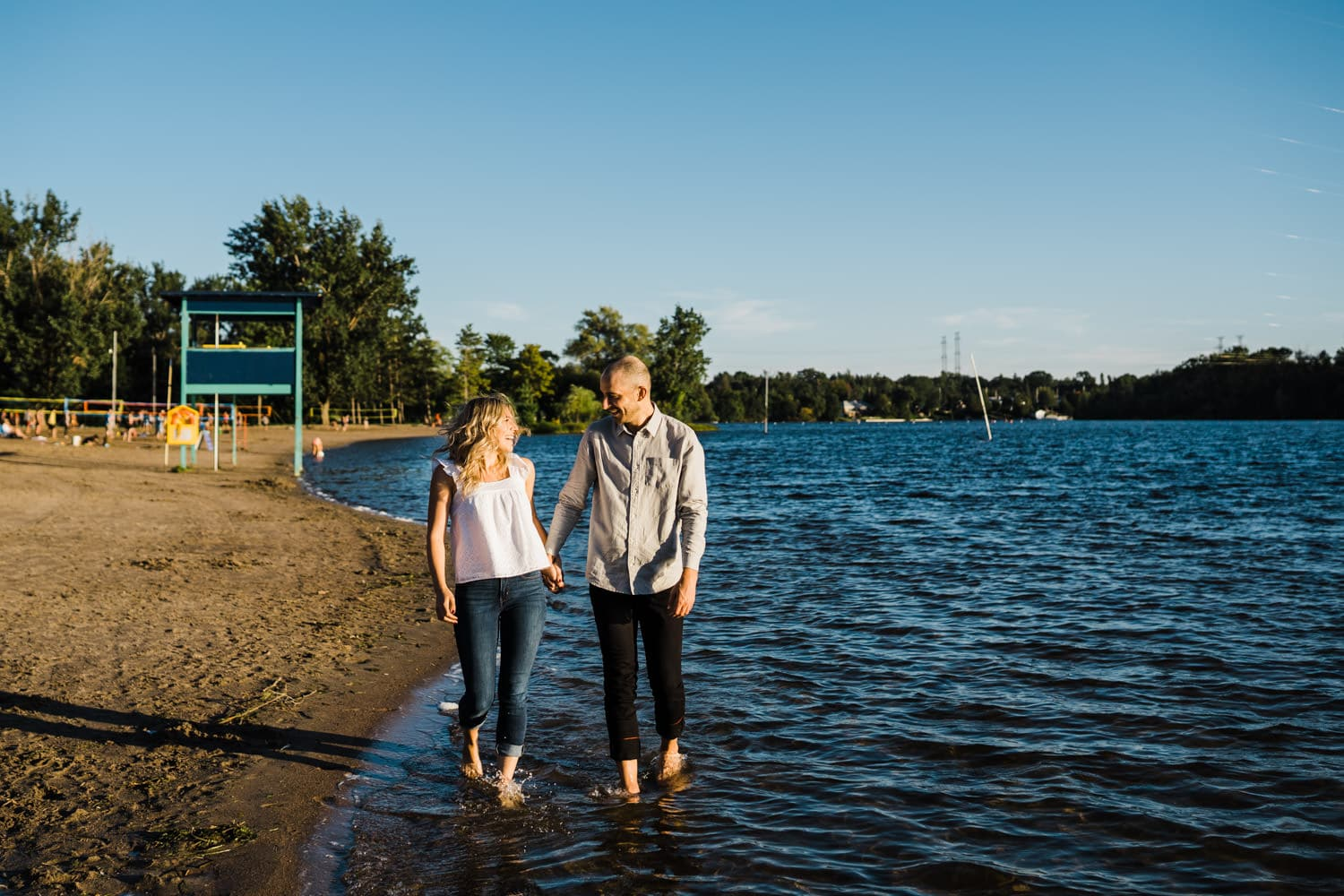 couple walk along the beach other - summer engagement session ottawa