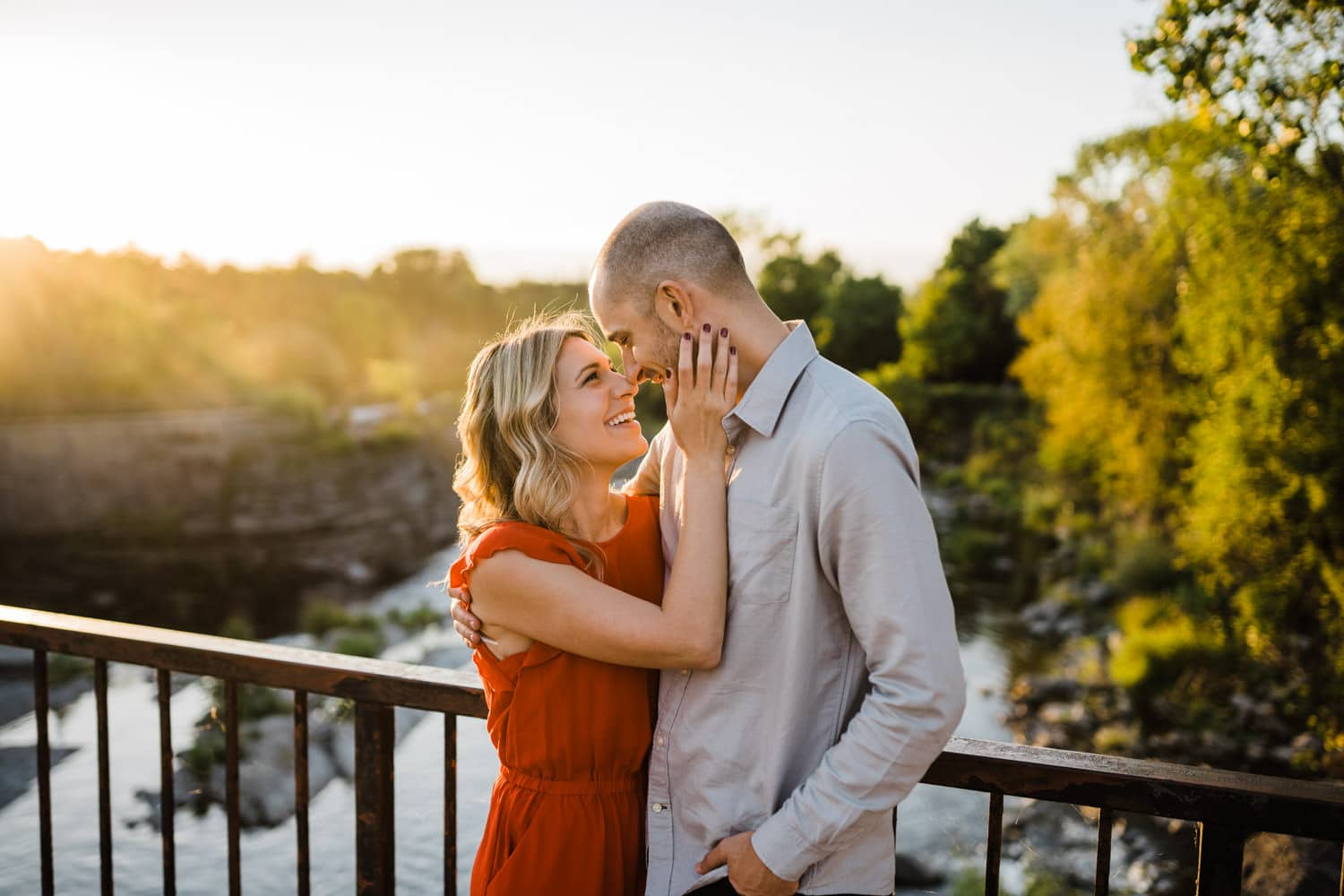 couple laugh together at hogs back - summer engagement session