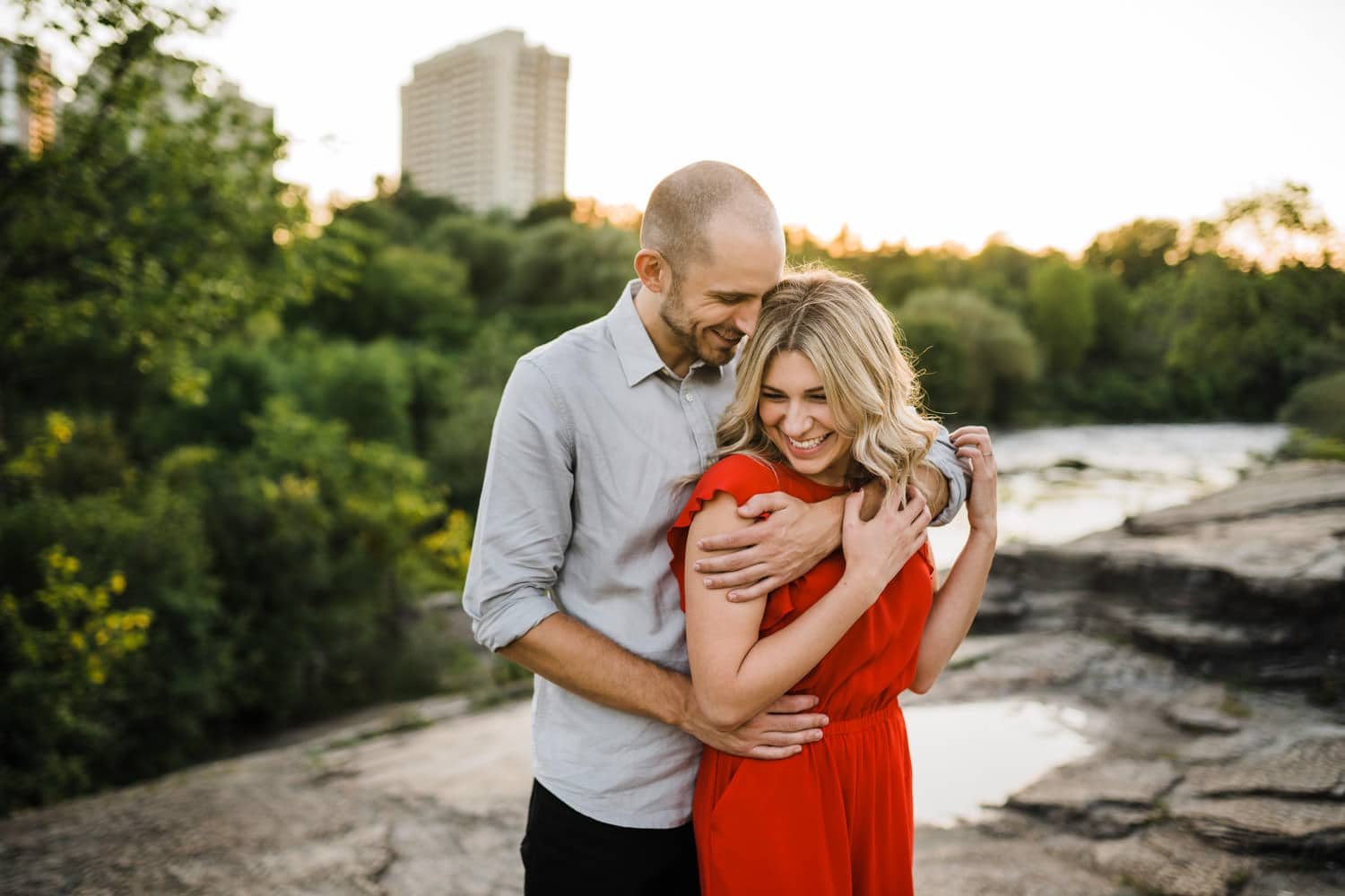 couple laugh together - hogs back engagement session - carley teresa photography