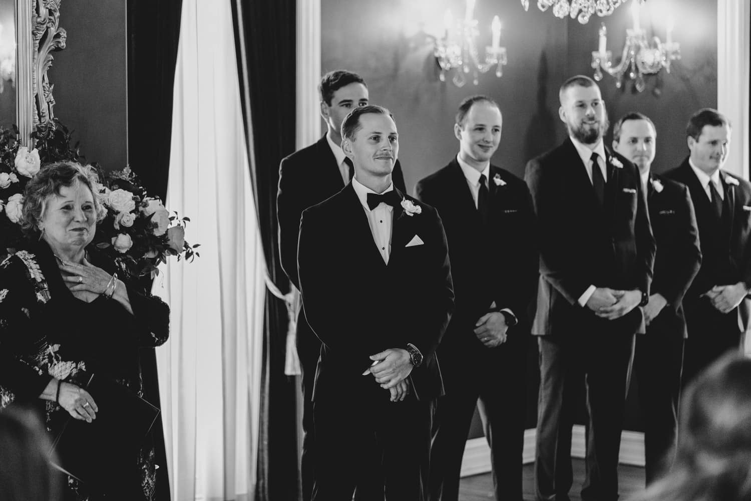 groom waits for his bride at the end of the aisle -the grand hotel wedding in carleton place
