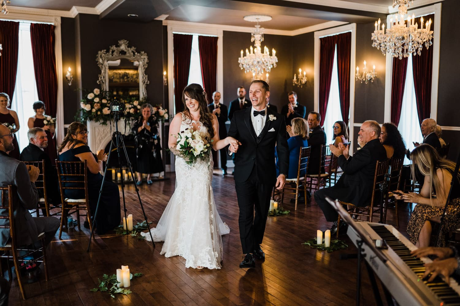 bride and groom walk down aisle after ceremony - the grand hotel wedding in carleton place