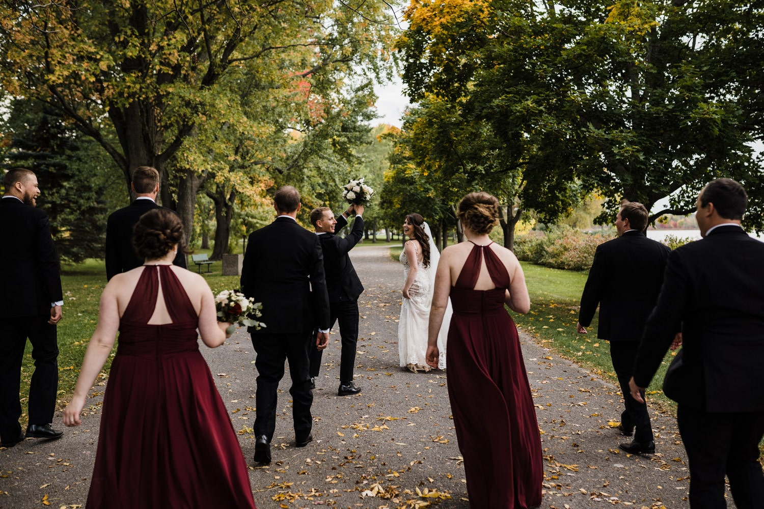 wedding party walks in a park together