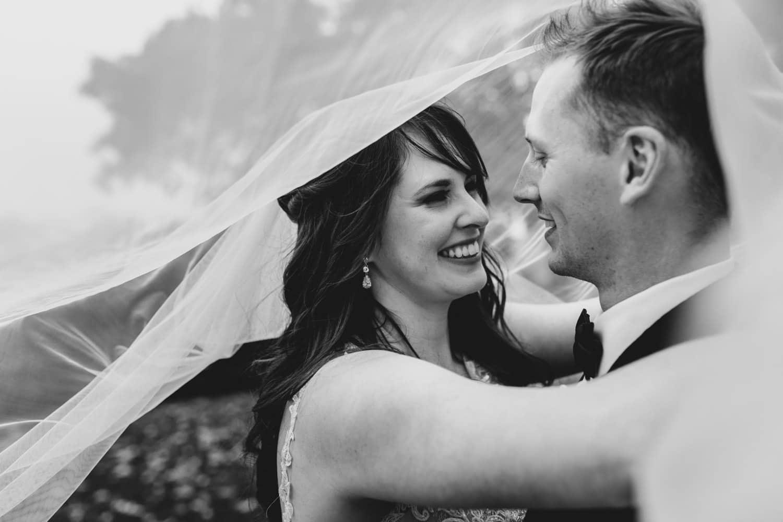 bride and groom hug outside together