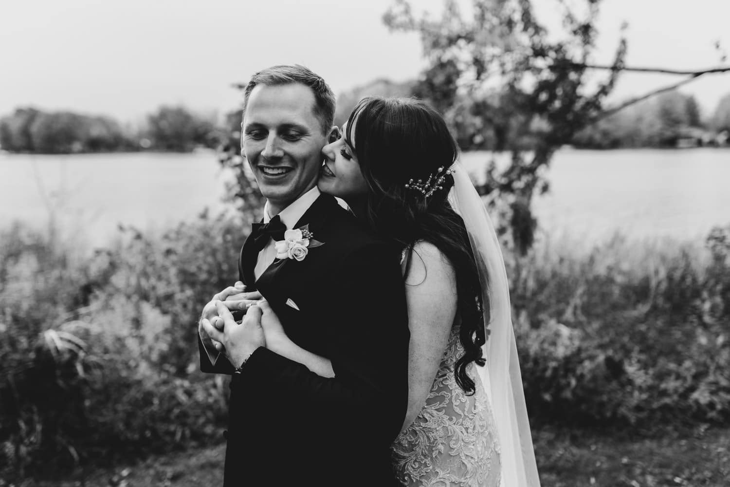 bride whispers something to groom - the grand hotel wedding in carleton place
