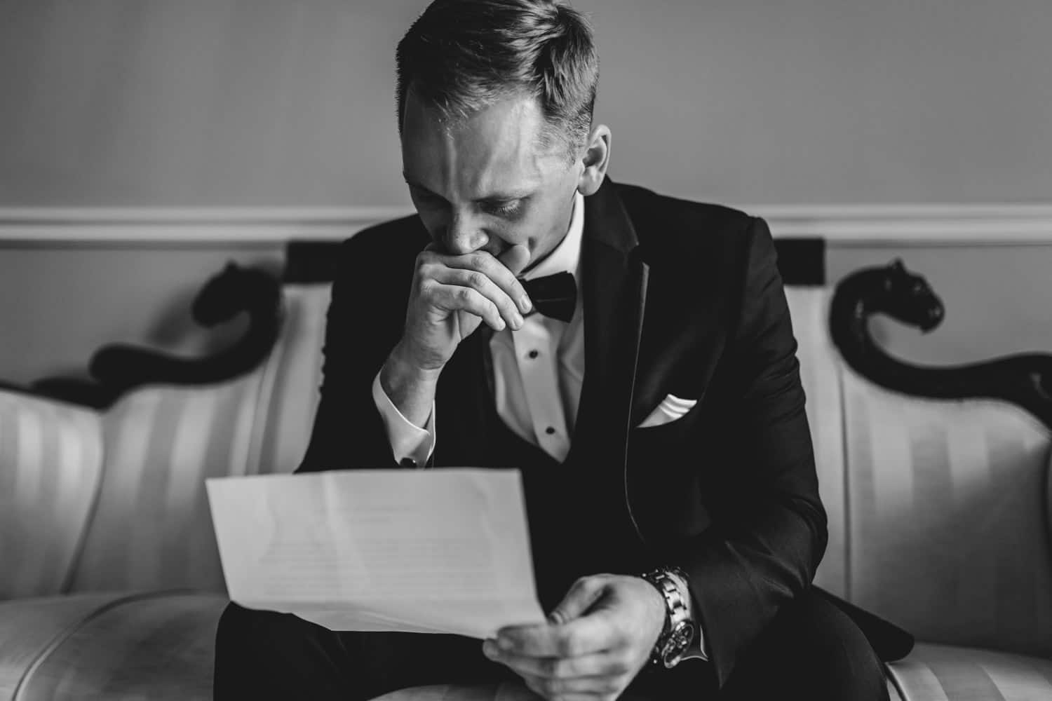 groom gets emotional as he reads a letter - the grand hotel wedding in carleton place